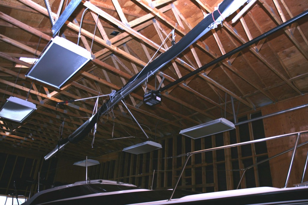 Mast raised in rafters with pulleys